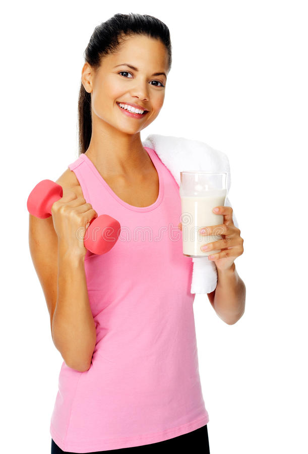 Gym shake woman. Portrait of a beautiful hispanic girl with dumbbell and protien shake stock photos