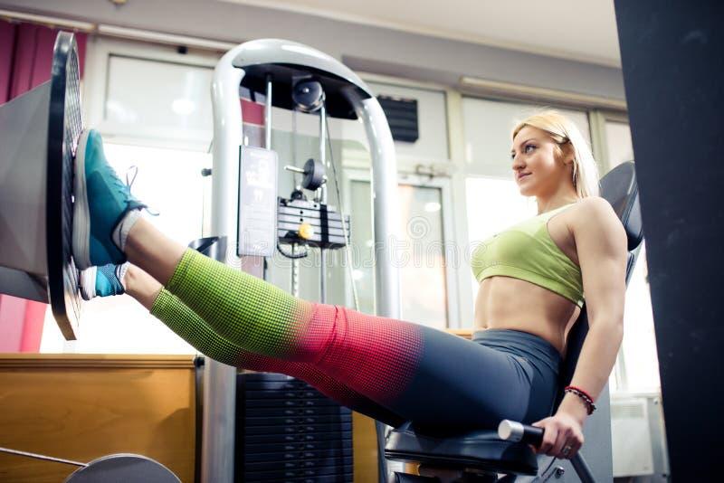 Gym training, young girl. On leg press stock photo
