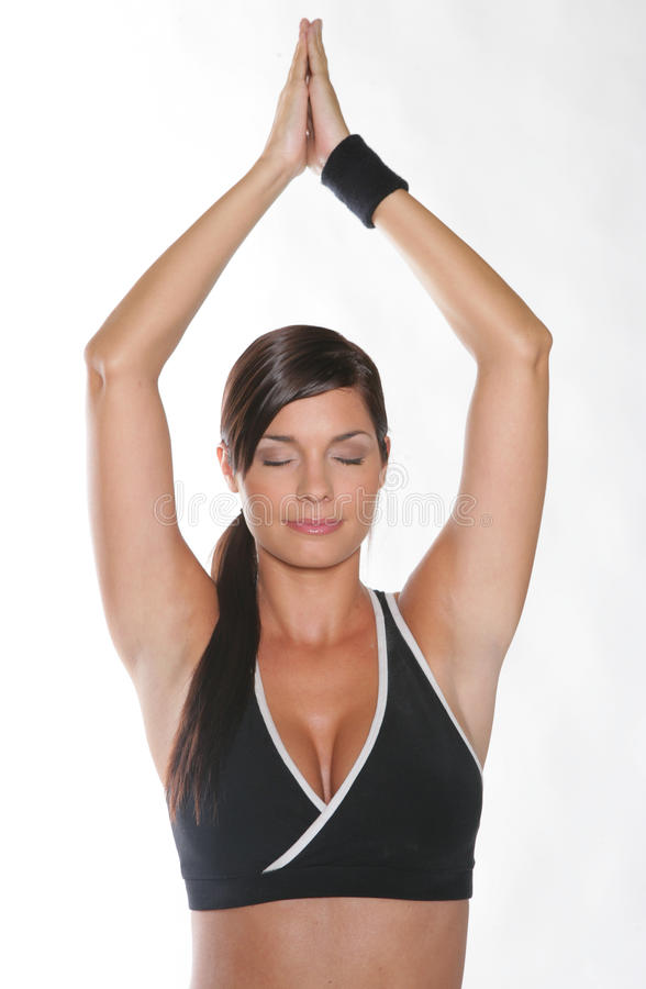 Gym woman. Doing stretching exercise at the gym royalty free stock images
