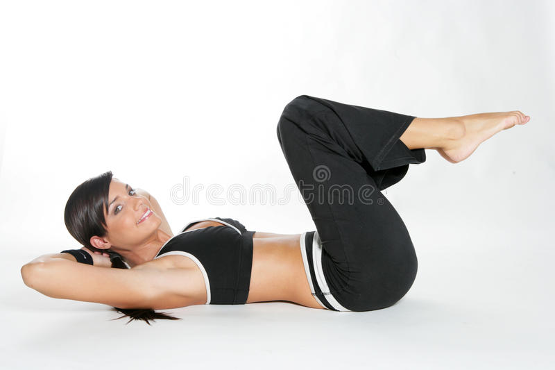 Gym woman. Doing stretching exercise at the gym stock photos