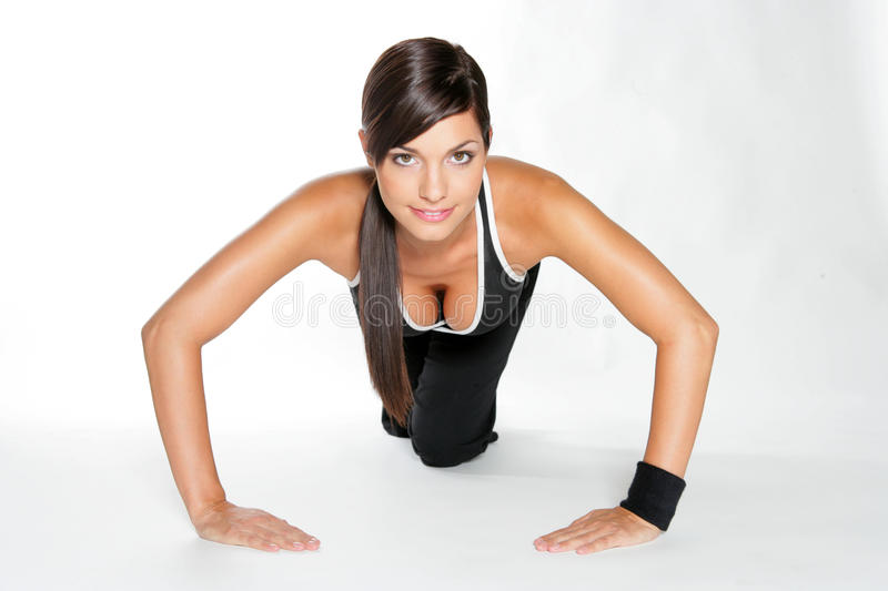 Gym woman. Doing stretching exercise at the gym royalty free stock image