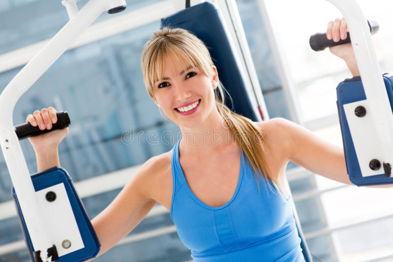 Download Gym woman stock photo. Image of machine, smile, smiling - 26034896