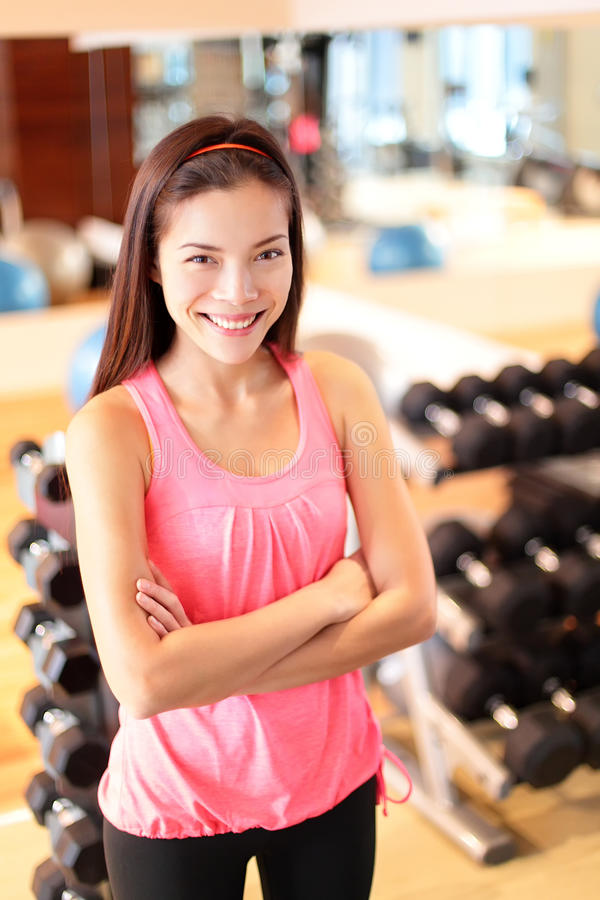 Gym woman in fitness center proud portrait royalty free stock images