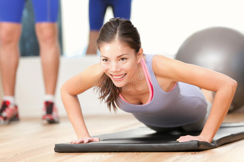 Gym woman working out stock photos