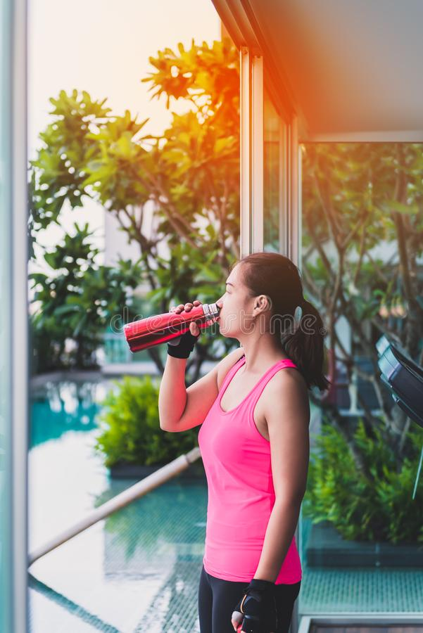 Gym woman working out drinking water at fitness center royalty free stock photos