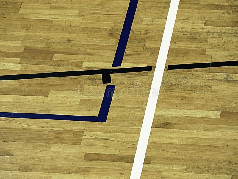 Gym wood floor with playground lines, parquet hardwood in school court. The floor viewed from above for texture pattern royalty free stock photo