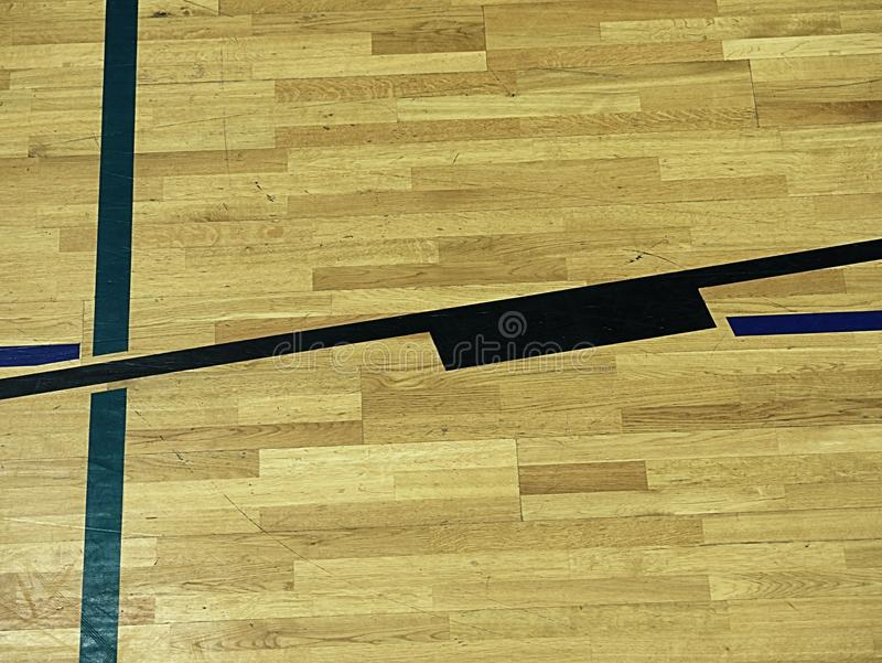 Gym wood floor with playground lines, parquet hardwood in school court. The floor viewed from above for texture pattern royalty free stock photos