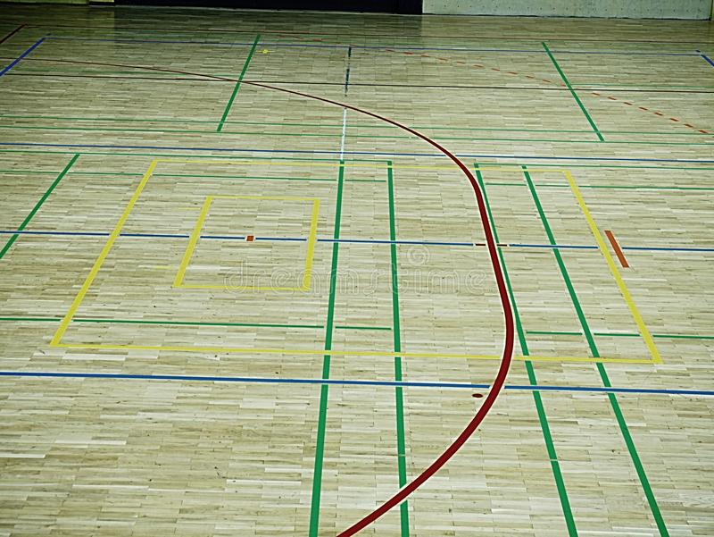 Gym wood floor with playground lines, parquet hardwood in school court. The floor viewed from above for texture pattern stock image