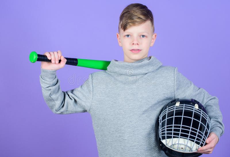 Gym workout of teen boy. Fitness diet brings health and energy. Baseball bat and helmet. Success. Childhood activity. Sport game. child sportsman. Confident stock photo
