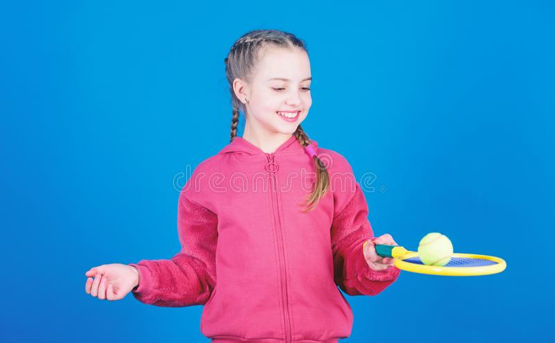 Gym workout of teen girl. Happy child play tennis ball. Little girl. Fitness diet brings health and energy. Tennis. Player with racket and ball. Childhood stock photo