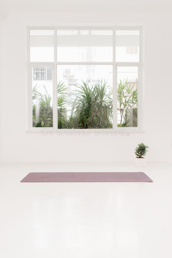Gym with yoga mat on the floor royalty free stock photos
