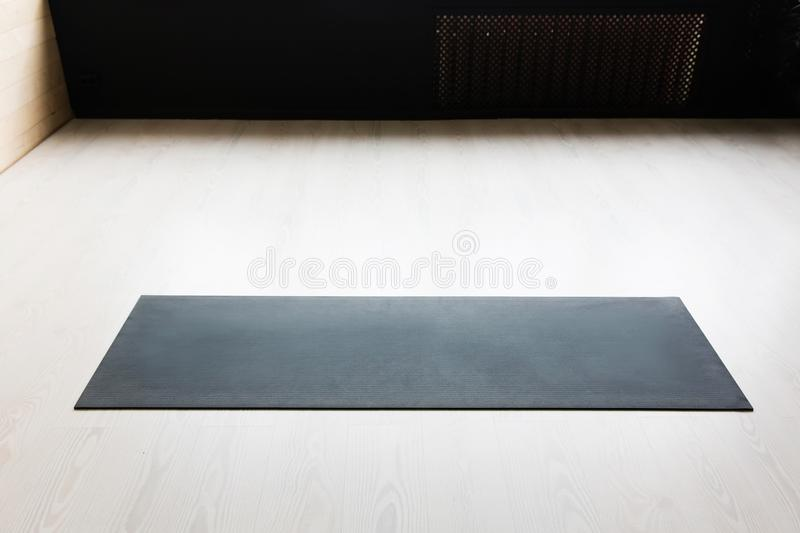 Gym with yoga mat interior stock photos