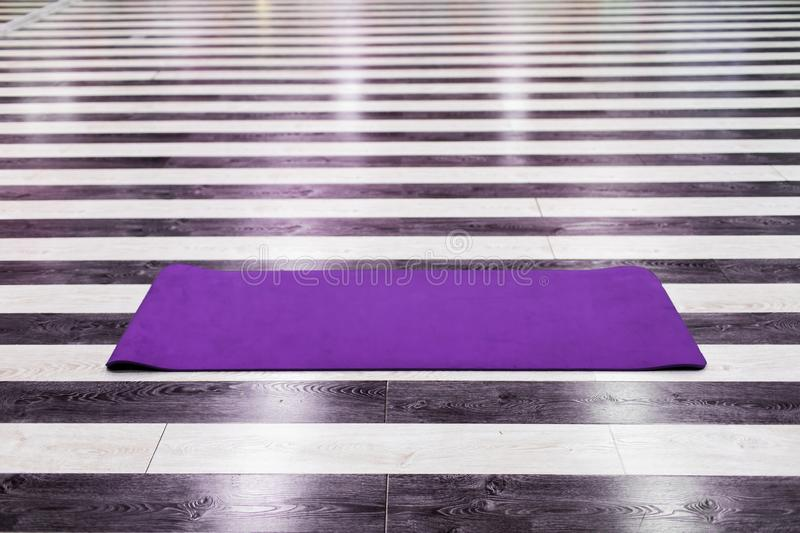Gym with yoga mat interior royalty free stock photography