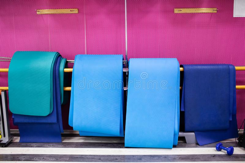 Gym with yoga mat interior stock photography
