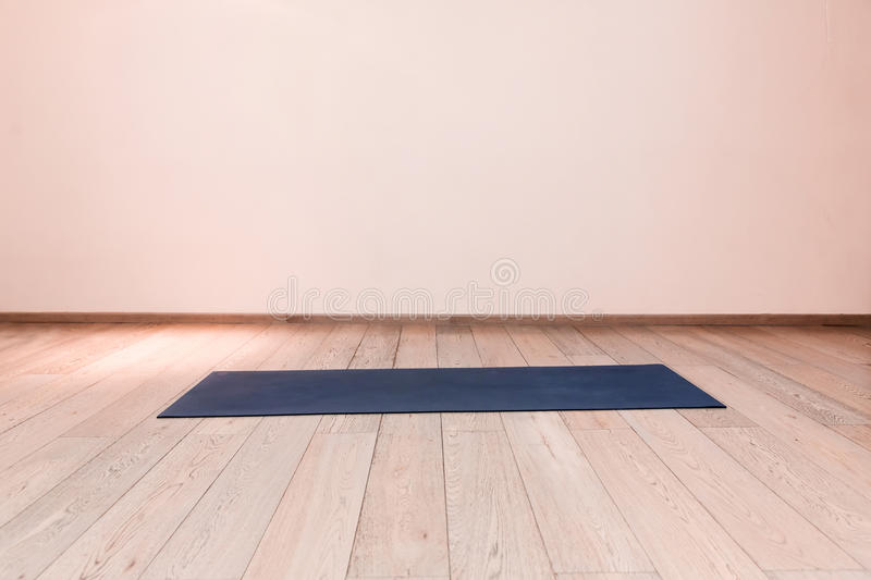 Gym with yoga mat royalty free stock photography