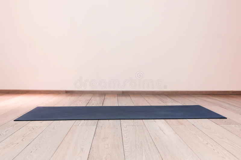 Gym with yoga mat stock photography