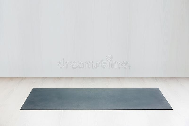 Gym with yoga mat interior royalty free stock images