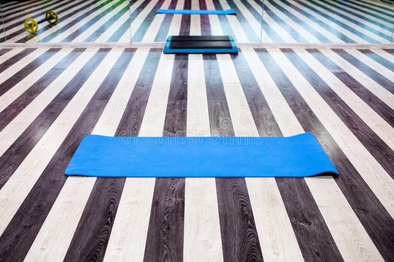Gym with yoga mat interior royalty free stock photo
