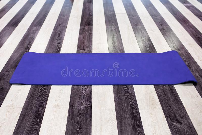 Gym with yoga mat interior stock photo