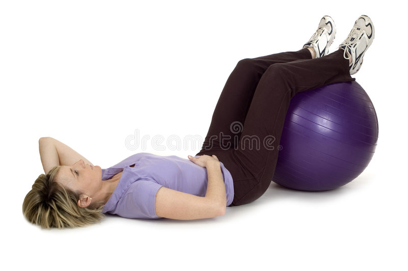 Gym19. Young women working out with gym ball royalty free stock photo