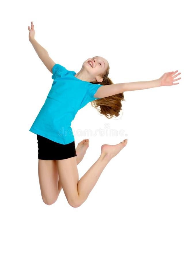 Gymnast κοριτσιών άλμα στοκ φωτογραφία