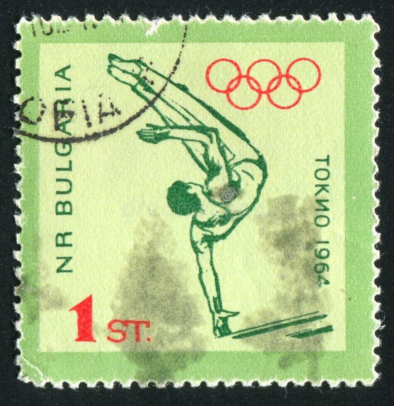 Gymnast auf parallelen Stäben lizenzfreie stockbilder