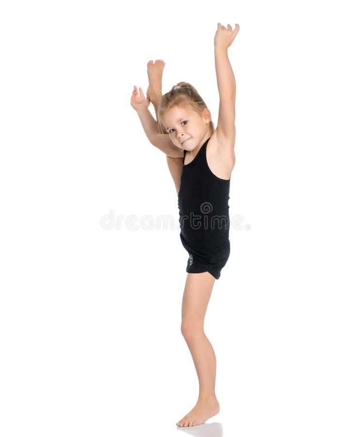 The gymnast balances on one leg. royalty free stock photos