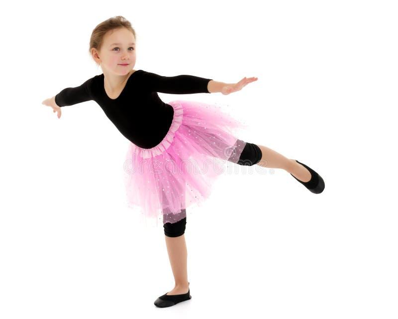 The gymnast balances on one leg. royalty free stock images