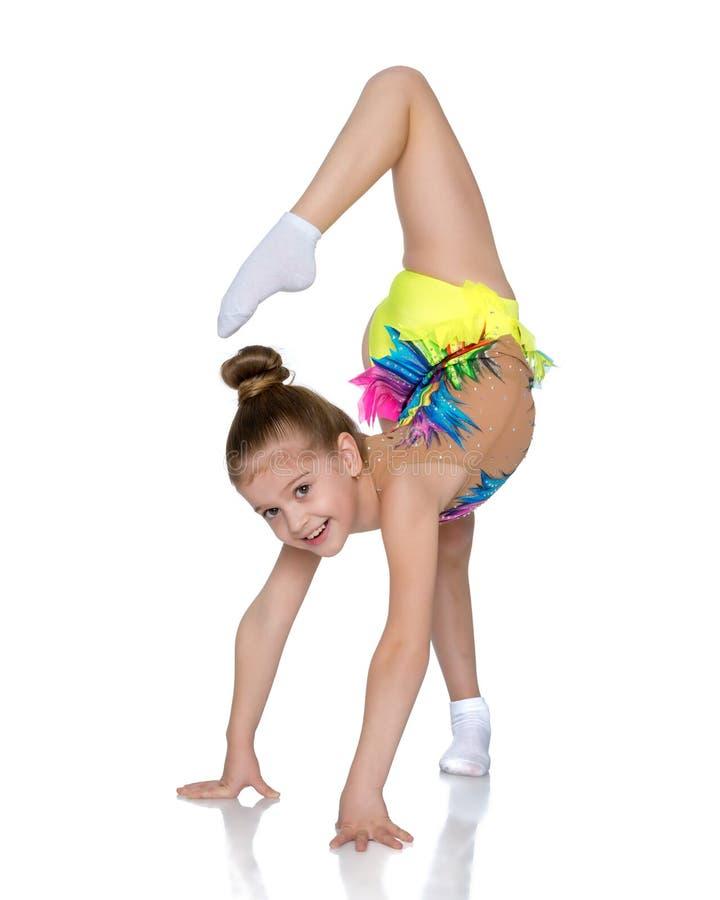 The gymnast balances on one leg. royalty free stock photo