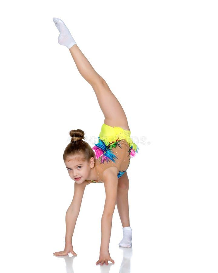 The gymnast balances on one leg. royalty free stock image