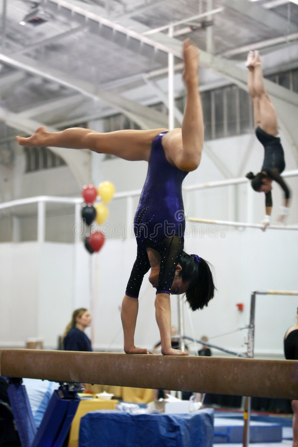 Gymnast on beam royalty free stock photo