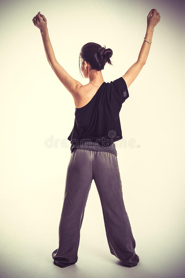 Gymnast in black suit royalty free stock photography