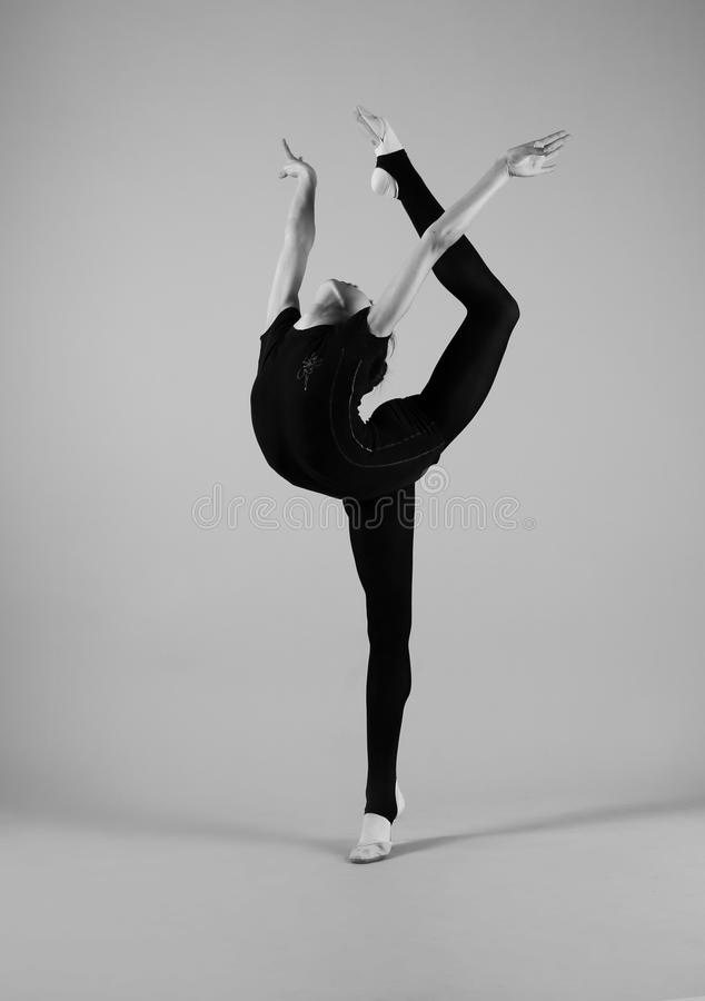 Gymnast in a black suit royalty free stock images