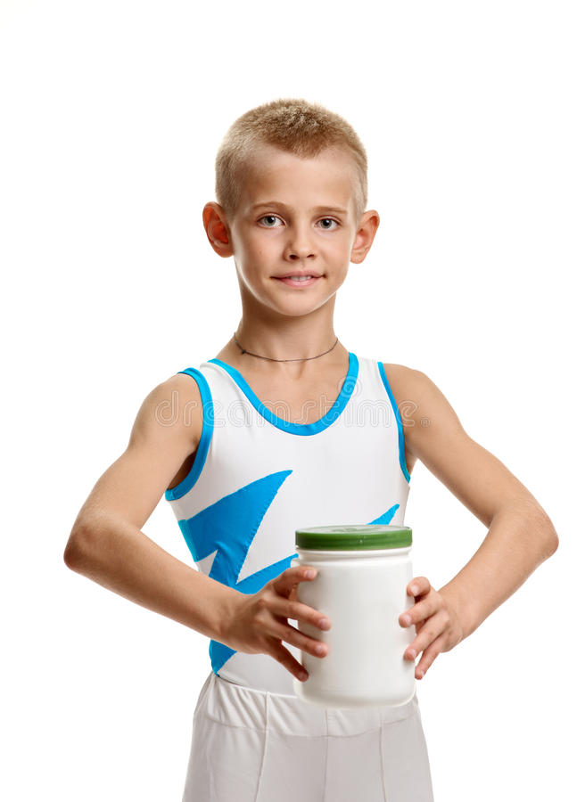 Gymnast with bodybuilding supplement. Young healthy gymnast showing jar with bodybuilding supplement royalty free stock photos