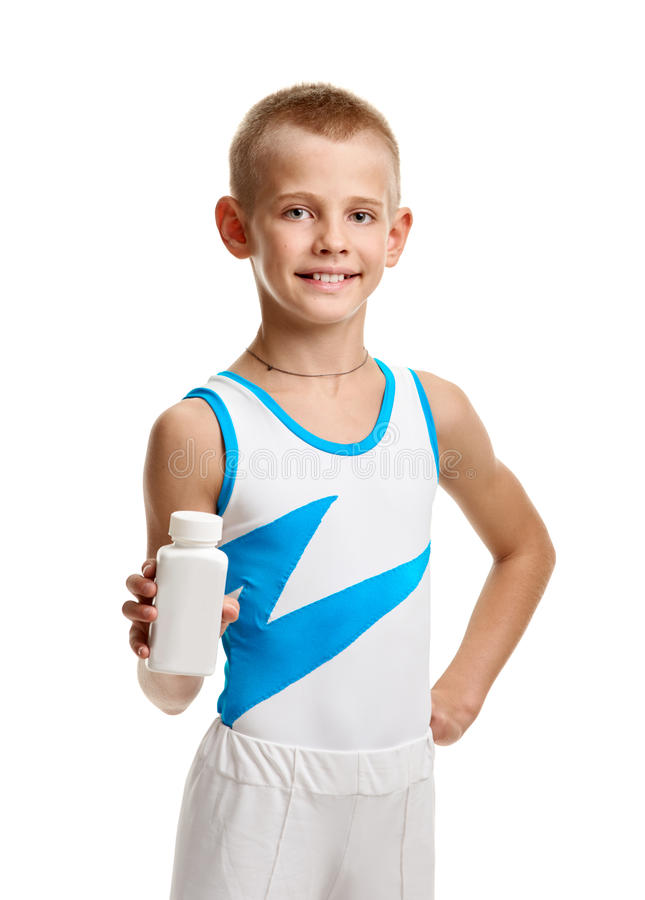 Gymnast with bodybuilding supplement. Young healthy gymnast showing jar with bodybuilding supplement royalty free stock images