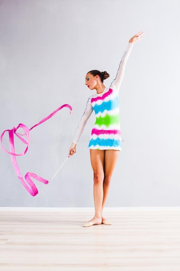 Gymnast com fita fotografia de stock royalty free