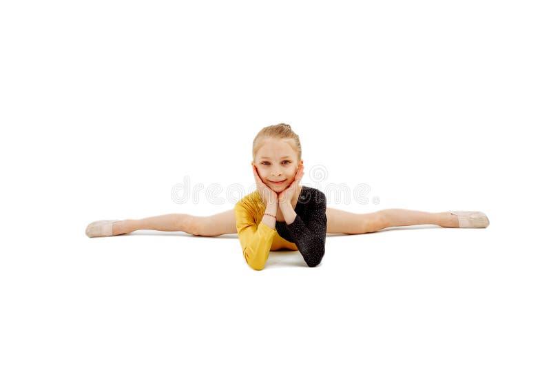 Gymnast doing a split. Arms horisontal stock photography