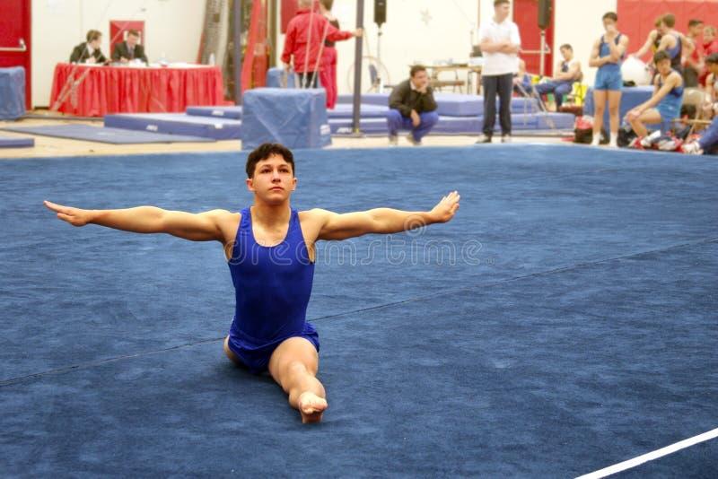 Gymnast on floor royalty free stock photo