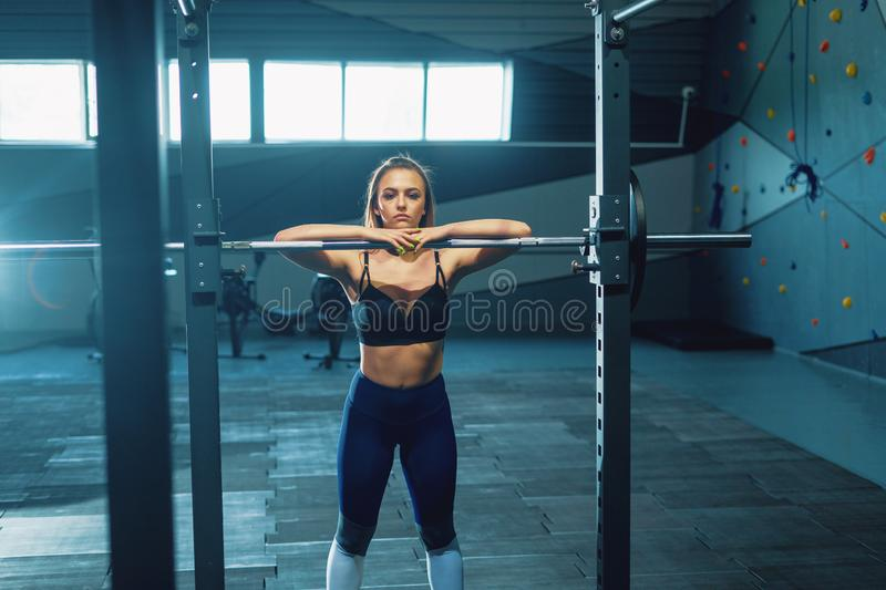 Gymnast girl doing squat barbell stock photography