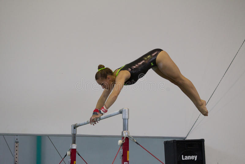 Gymnast Girl Parallel Bars Swinging stock photography