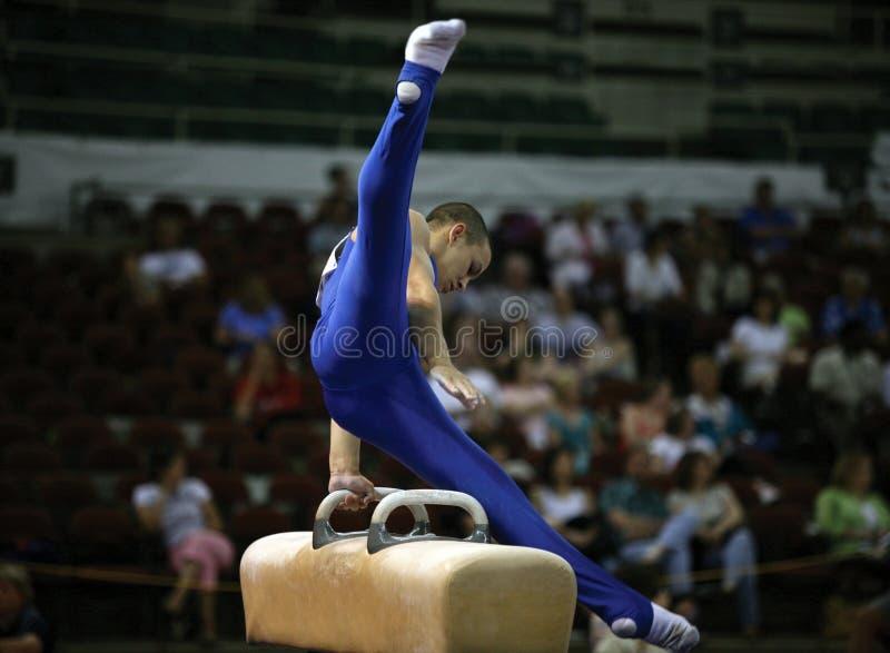 Gymnast no pommel foto de stock royalty free