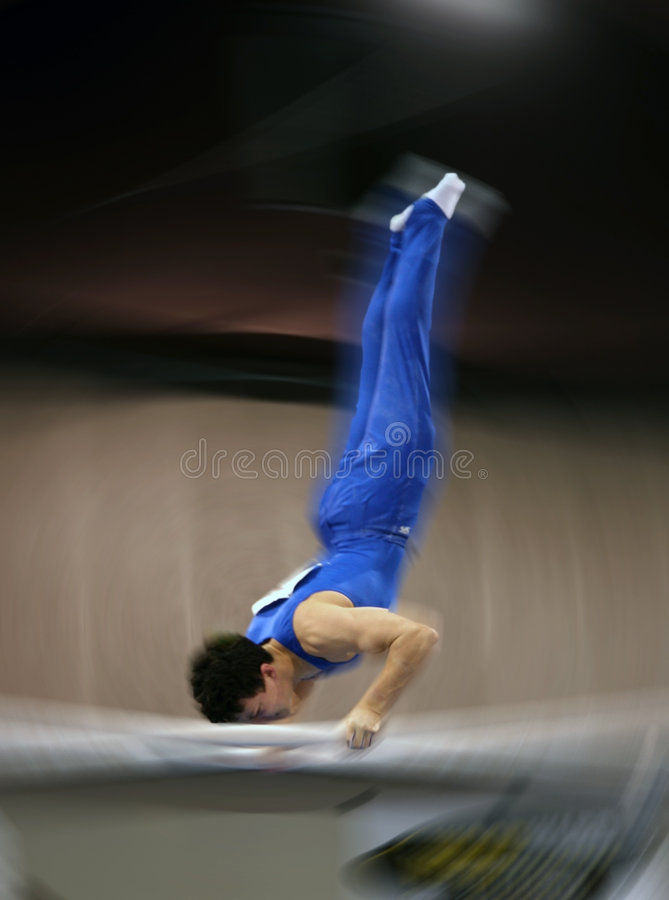 Gymnast on parallel bar stock photo