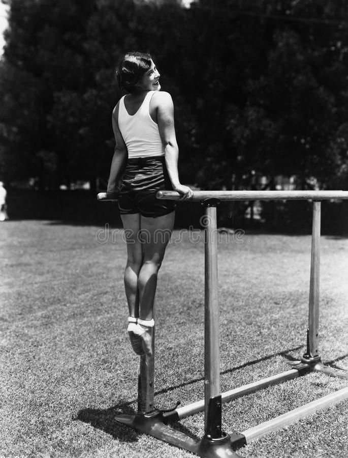 Gymnast on parallel bars outside royalty free stock photo