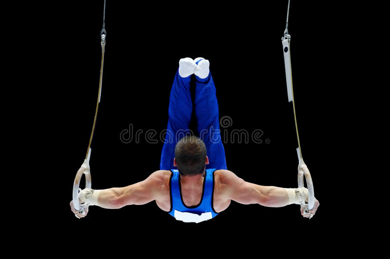 Gymnast Performing On The Rings
