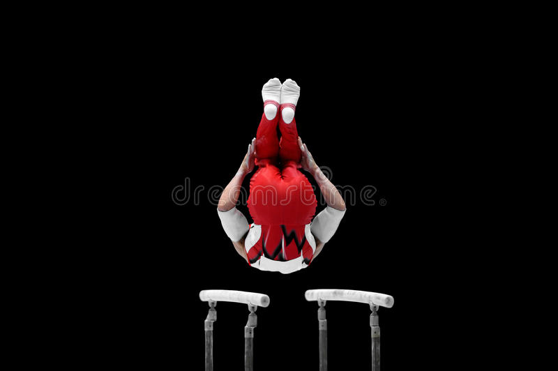 Gymnast Performs On The Parallel Bars stock images