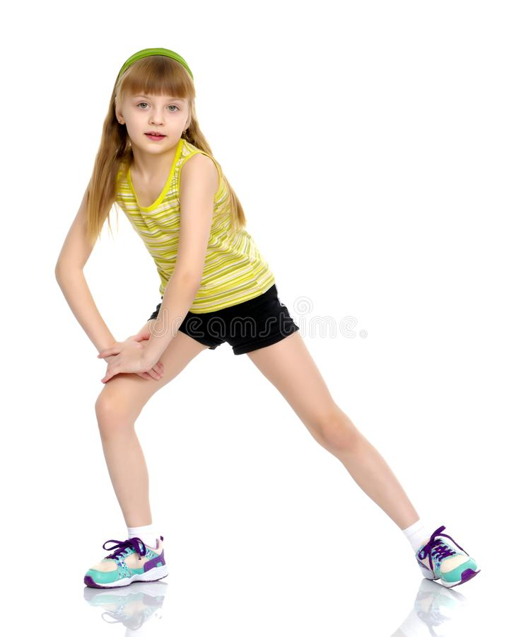 The gymnast prepares to perform the exercise. royalty free stock image