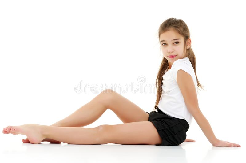 The gymnast prepares to perform the exercise. royalty free stock photography