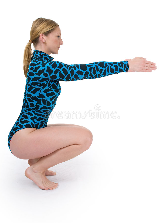 Gymnast que squating fotos de stock royalty free