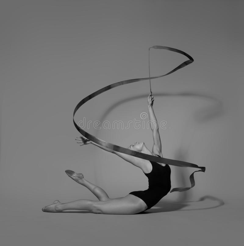 Gymnast with a ribbon  deflection back. Gymnast with a ribbon royalty free stock images
