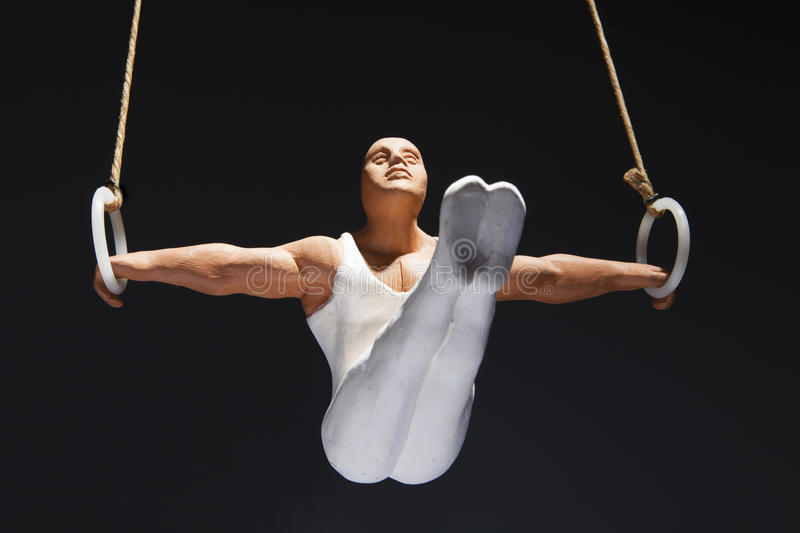 Gymnast on the rings royalty free stock photo